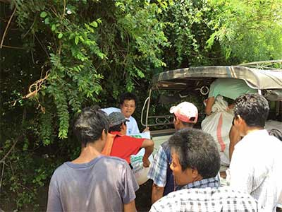 Kaung Nyunt and Kyaw Zin Win help volunteers load a truck with rice and other supplies.